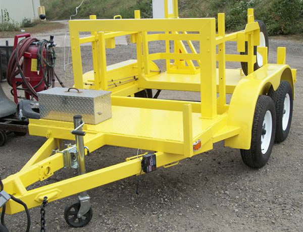 Yellow construction paint powder coating on a trailor